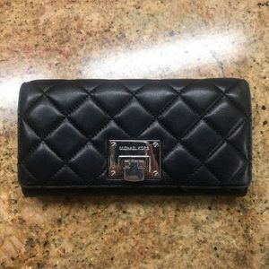 Black Michael Kors stitched wallet